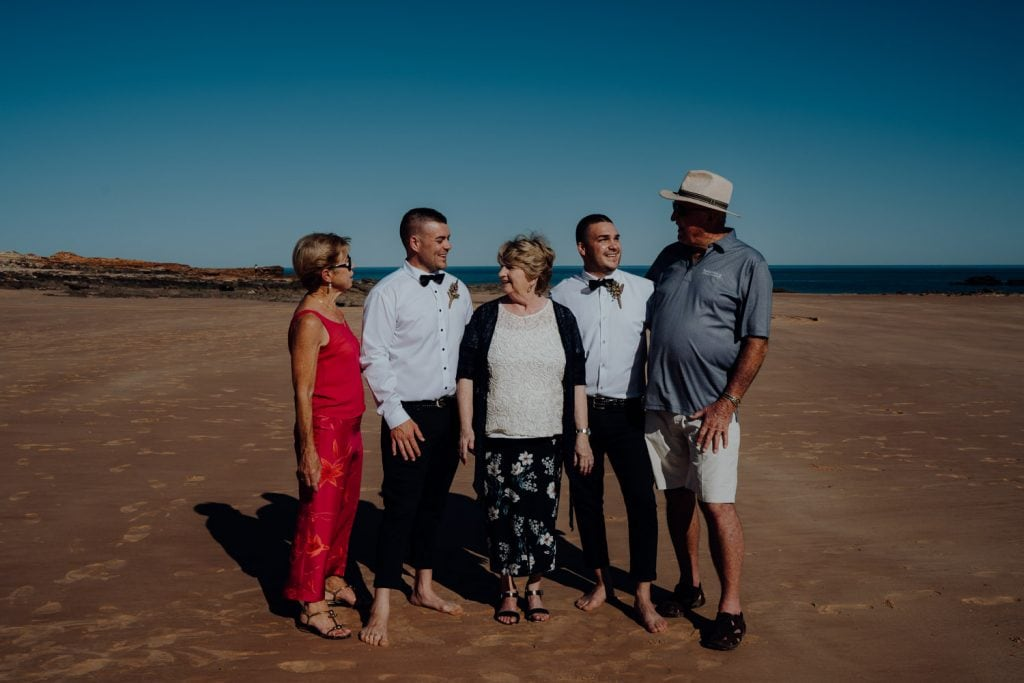 family group photo with groom at relaxed beach wedding at Entrance Point