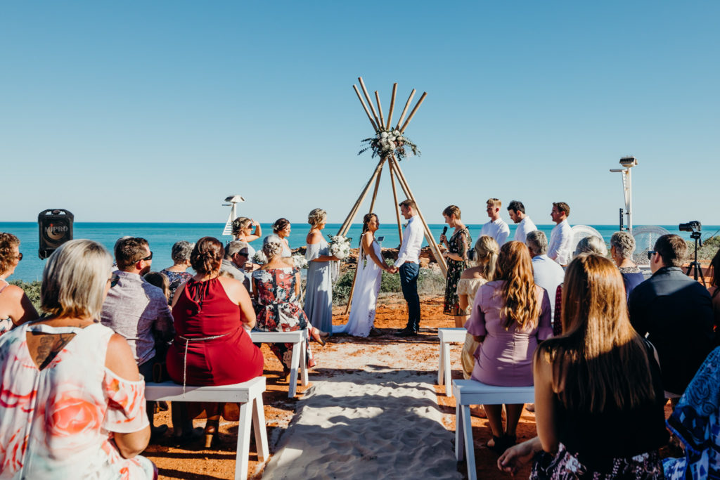 ceremony at Broome Fishing Club wedding with ocean as backdrop