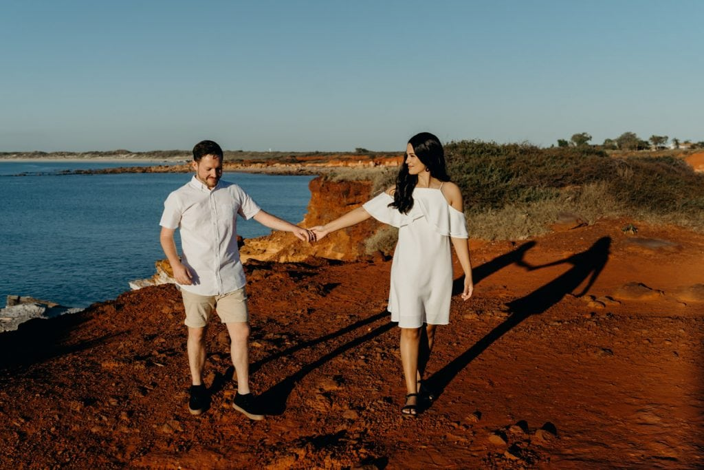 young couple dressed in white at engagement session in Broome with photographer Julia Rau