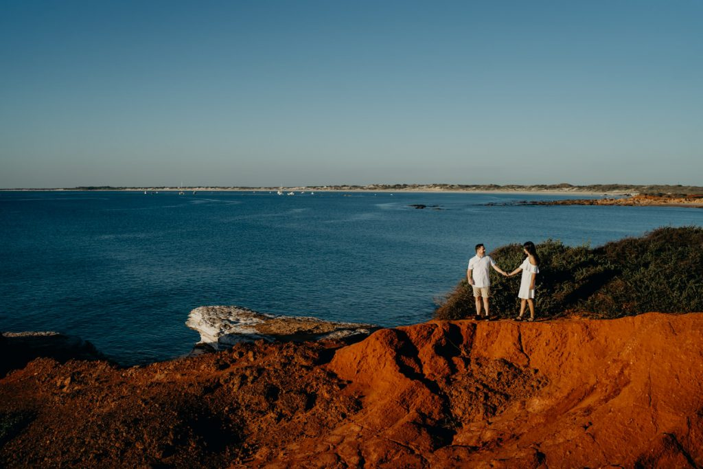 couple on top of cliff at Gantheaume Point in Broome during engagement photo shoot