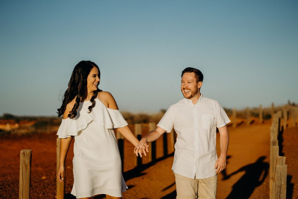 woman leads her fiancé along a path at Gantheaume Point in Broome