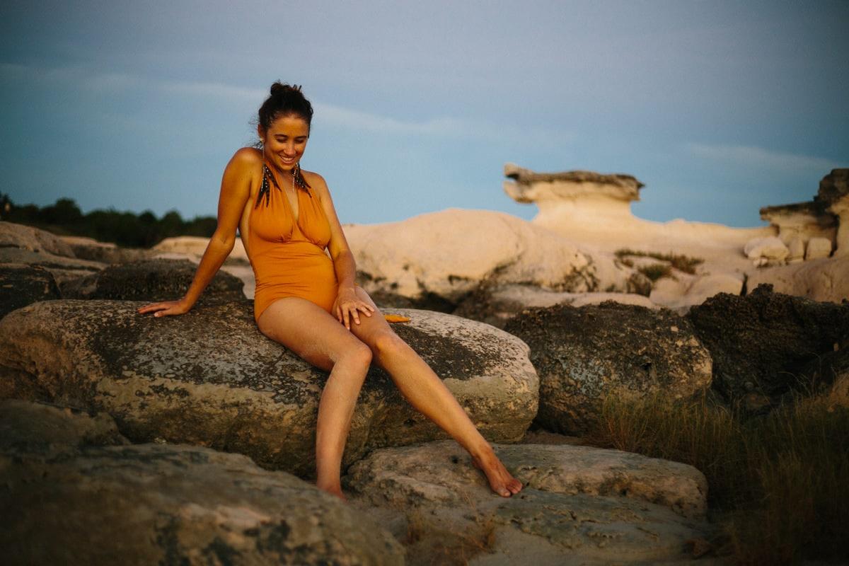woman in orange swim wear