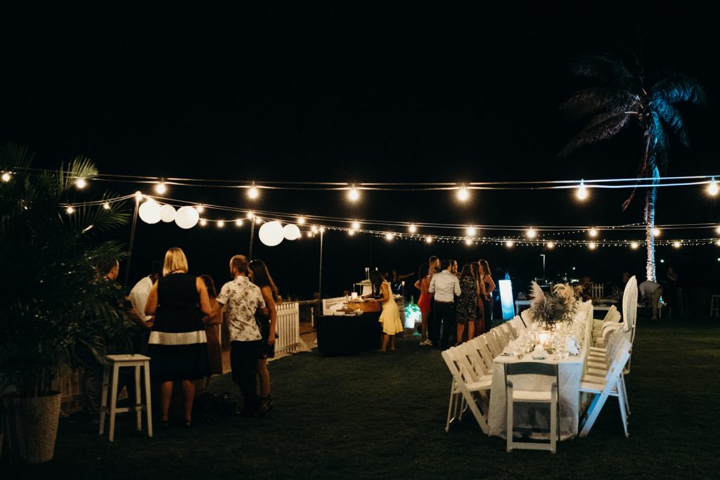 long table dinner set up with wedding guests mingling at Broome Surf Club