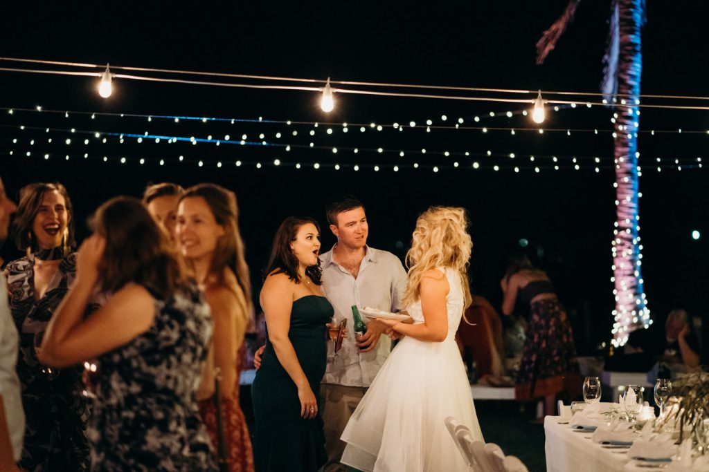 bride and her guests chatting at Broome Surf Club reception at Broome Catamaran wedding