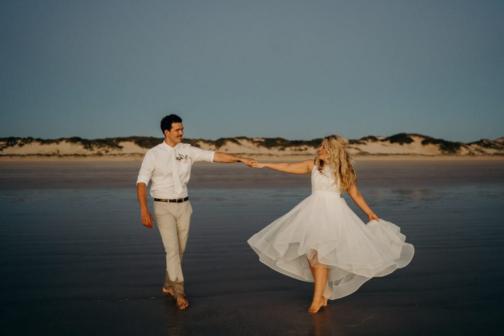 young married couple dancing on Cable Beach in Broome at the end of the Broome Catamaran Wedding
