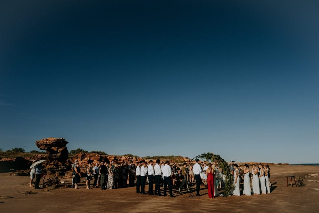 wide shot of Broome Entrance Point wedding featuring blue sky and sunshine