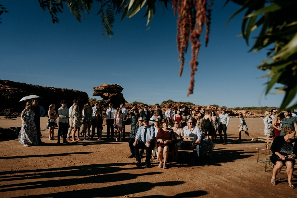 wedding guests seated at Entrance Point beach wedding in Broome