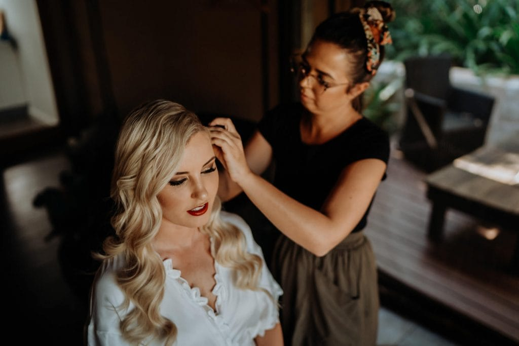 Bonnie Louise is doing makeup for bride in preparation of Broome Entrance Point wedding