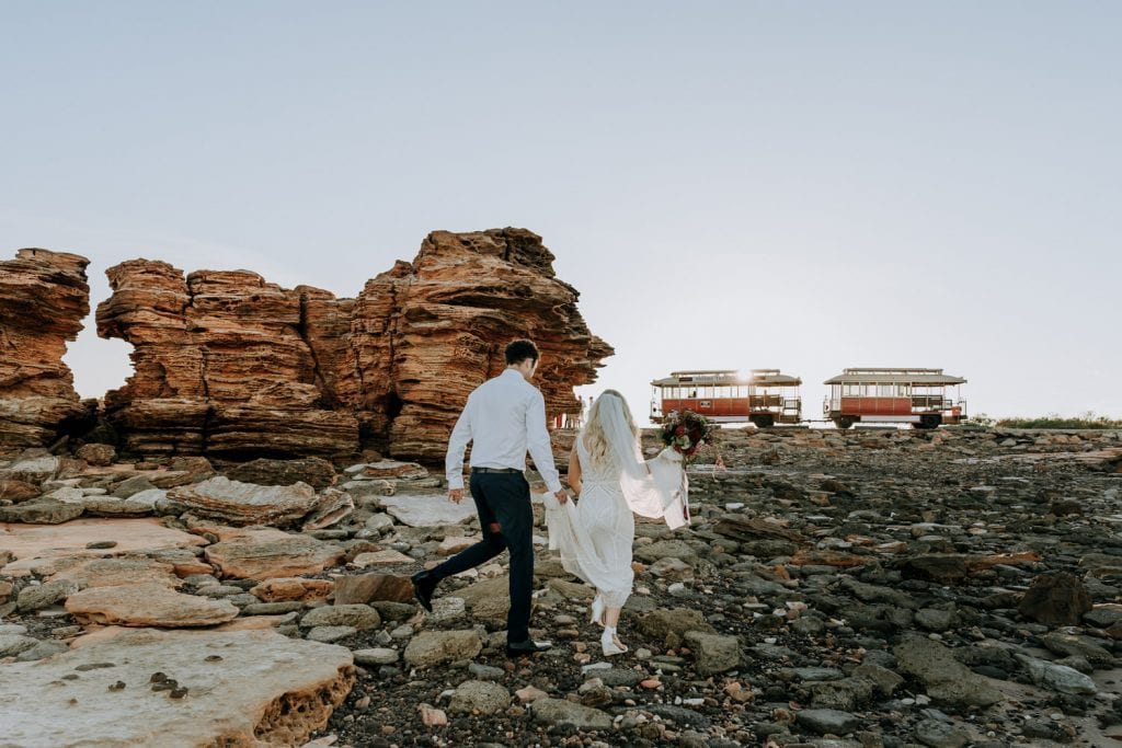 wedding couple walks towards Broome Tramway at Entrance Point in Broome