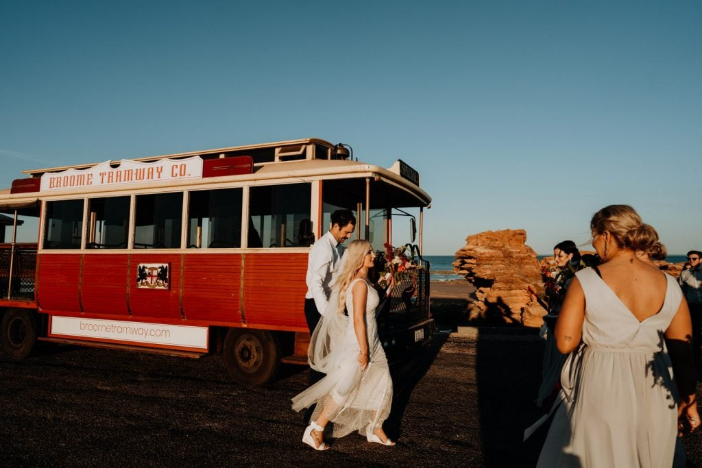 bride and groom and bridal party walkin towards Broome Tramway at Entrance Point in Broome