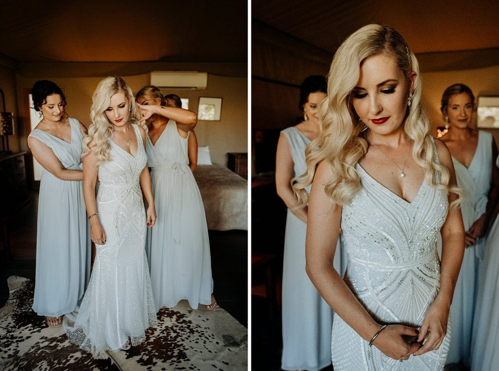 bride is getting in to her wedding dress at the Billi Resort for her Broome Entrance Point Wedding