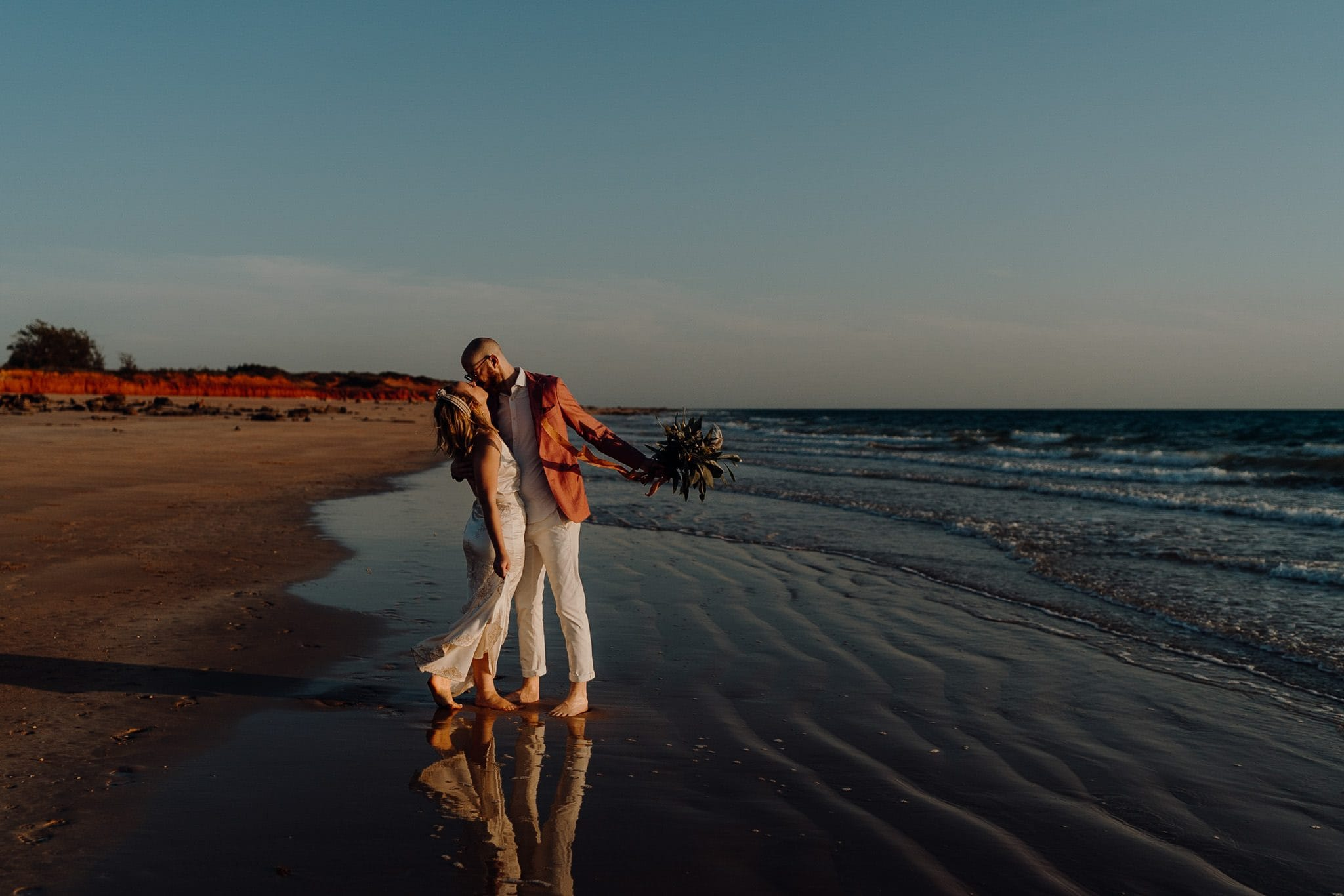 Broome Elopement Wedding couple on the beach kissing
