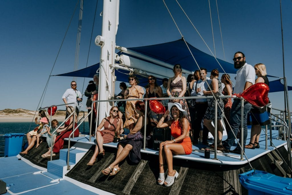 group of people in summer clothes waiting for bride to arrive on the Karma IV Broome catamaran