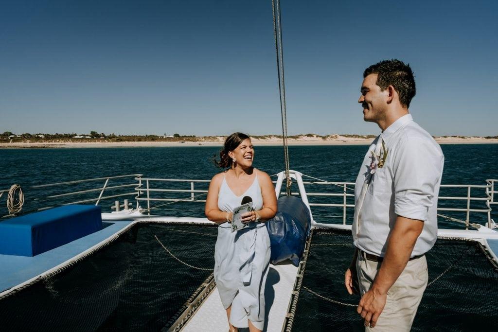 Elle Saunders Marriage Celebrant smiles at groom at Broome catamaran wedding