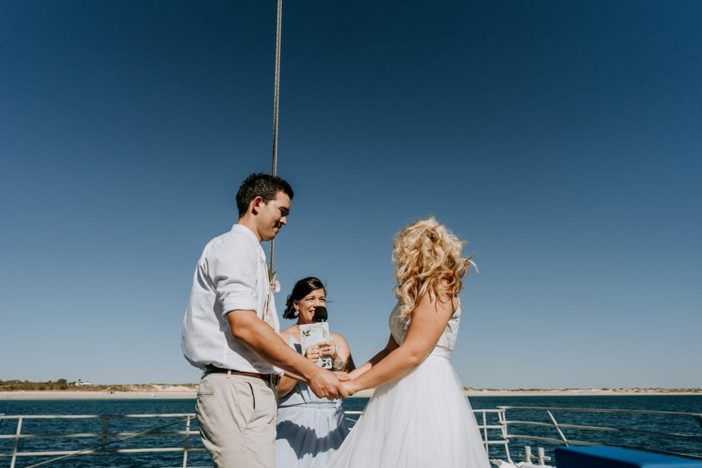 wedding ceremony taking place on a sailing catamaran off Broome in the Kimberley in Western Australia