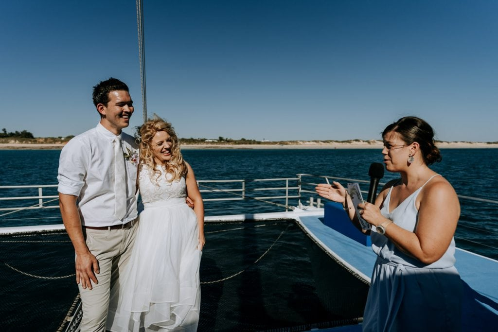 Broome marriage celebrant Elle Saunders declares young couple as husband and wife on Broome catamaran