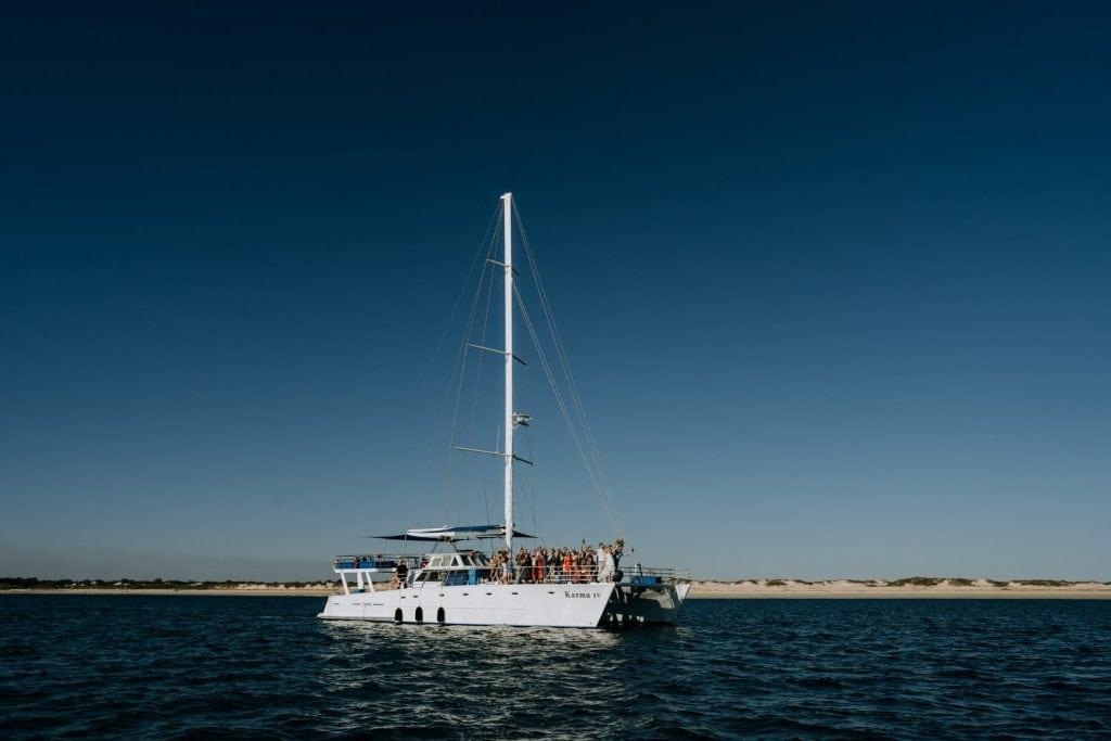 Broome catamaran Karma IV anchored off Cable Beach in the Kimberley in Western Australia