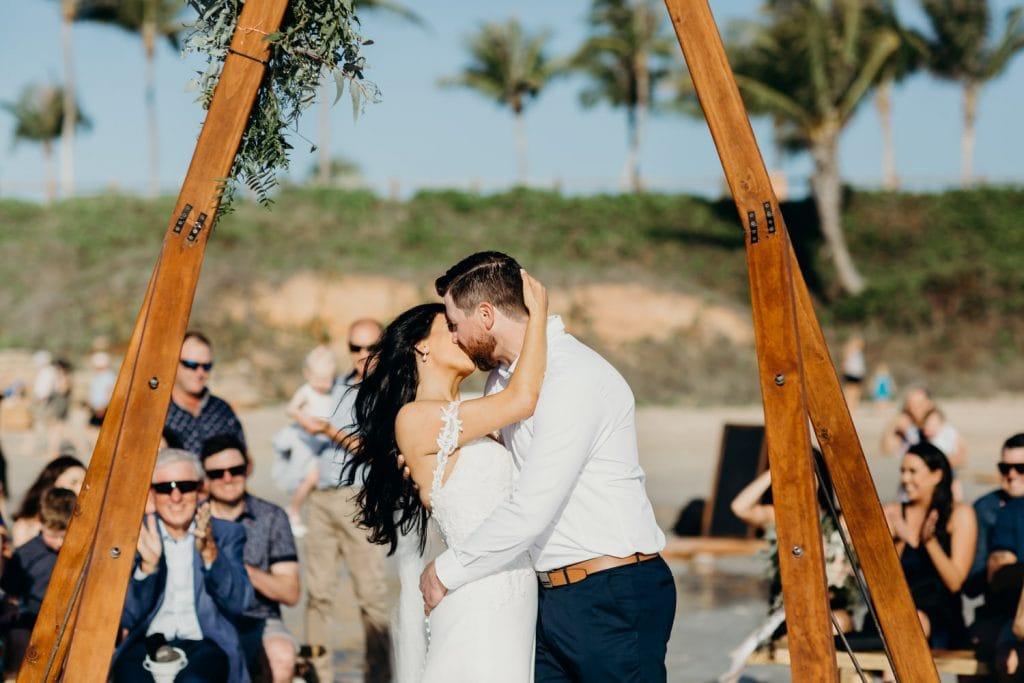 wedding couple's first kiss as husband and wife on Cable Beach in Broome