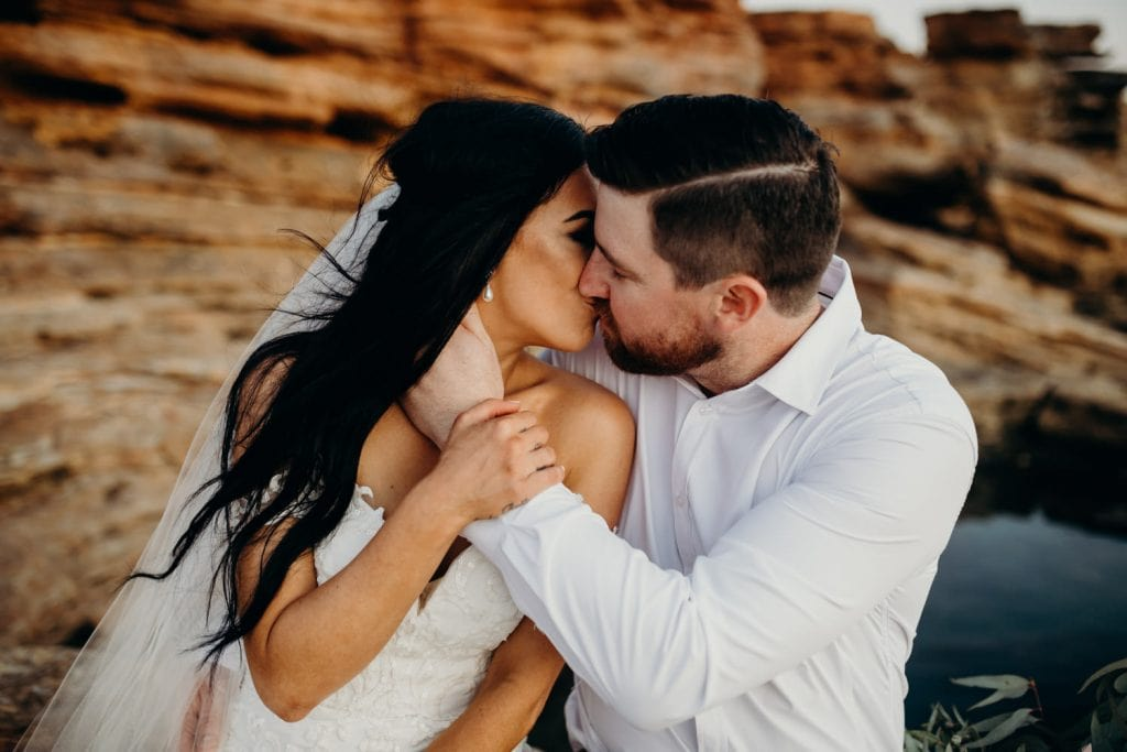 kissing wedding couple in Broome Western Australia