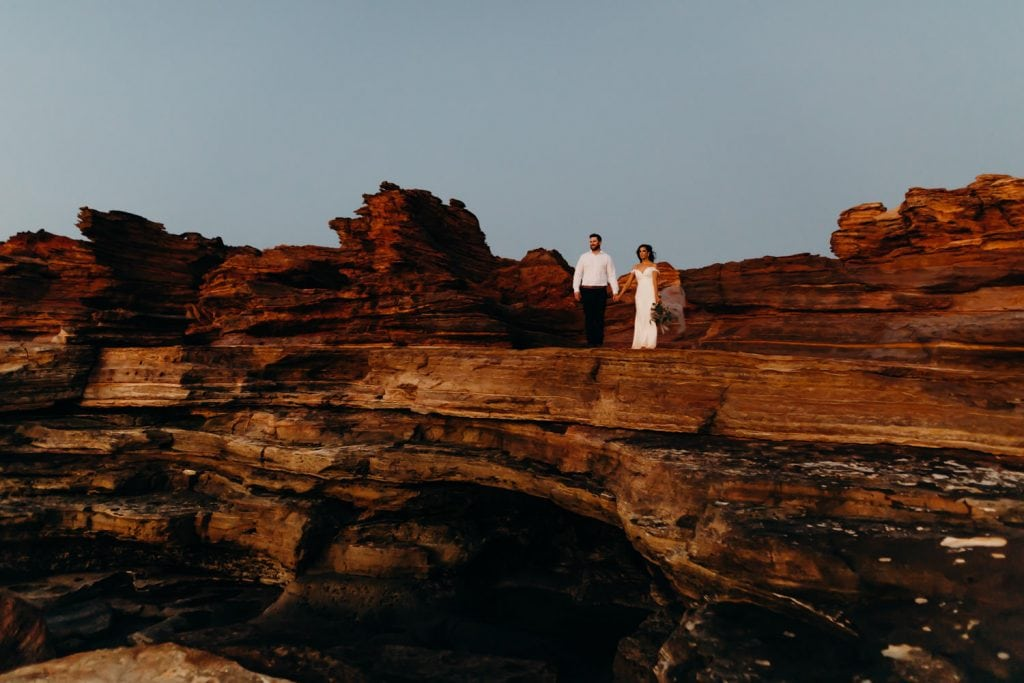 low light photograph of wedding couple on rocks at Gantheaume Point in Broome