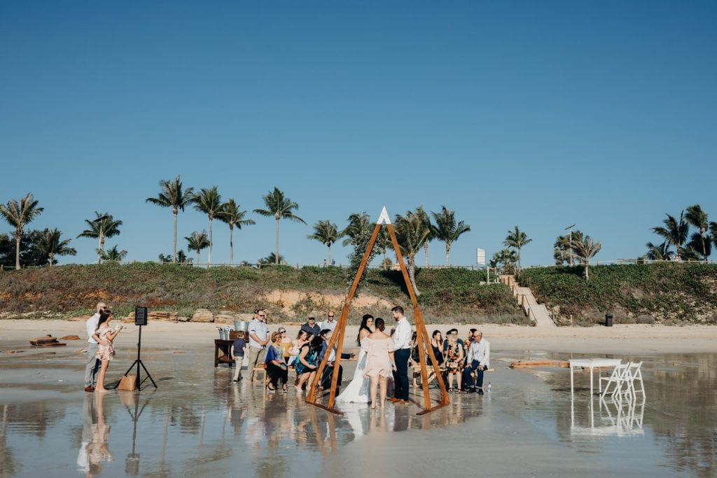 wedding on Cable Beach in Broome with palm trees in the backgroun