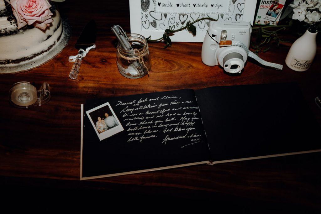 guest book at wedding with polaroid camera