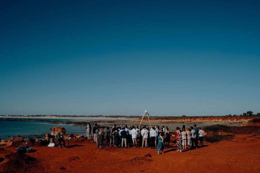 wide shot of a clifftop wedding at Gantheaume Point