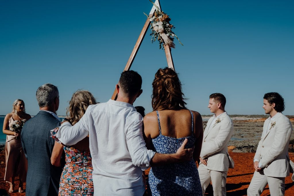 group of people watching wedding at Gantheaume Point in Broome