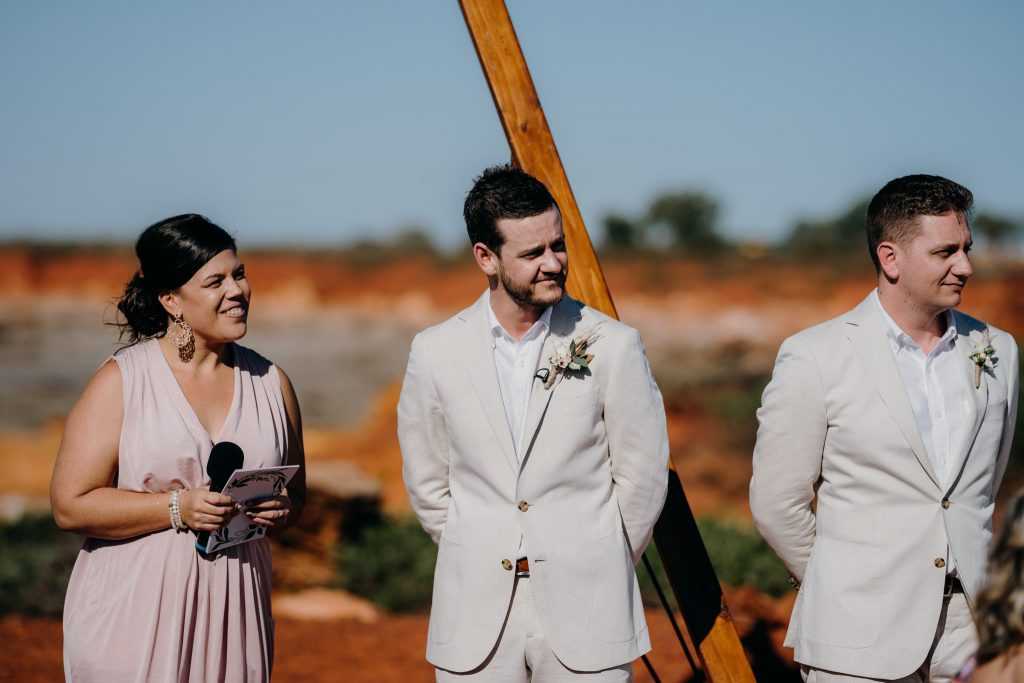 marriage celebrant Elle Saunders and the groom are looking out for the bride to arrive