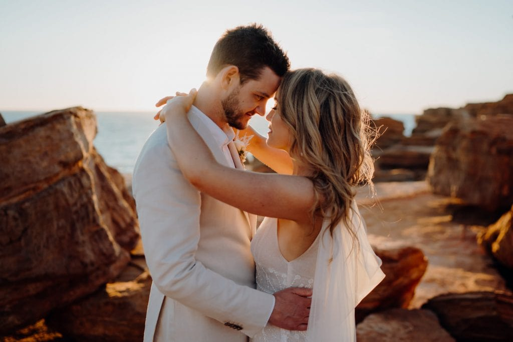 portrait of wedding couple taking in the moment at sunset at their wedding at Gantheaume Point