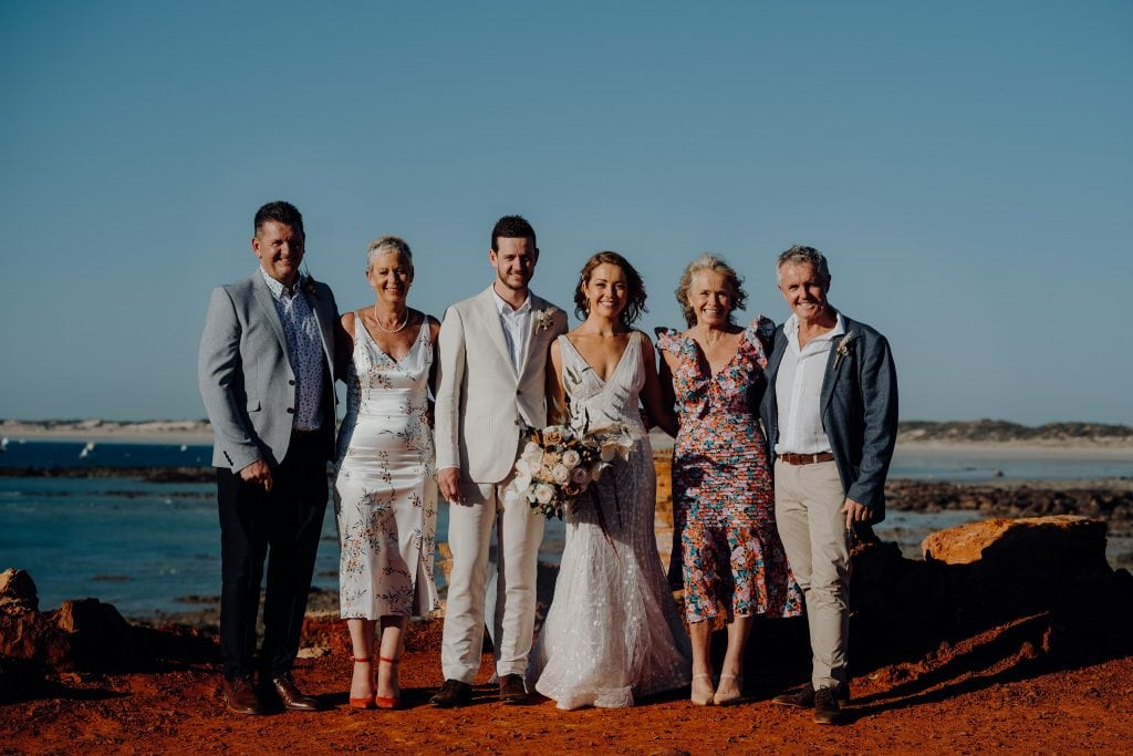 group shot of bride and groom with both sets of parents at Gantheaume Point in Broome Western Australia