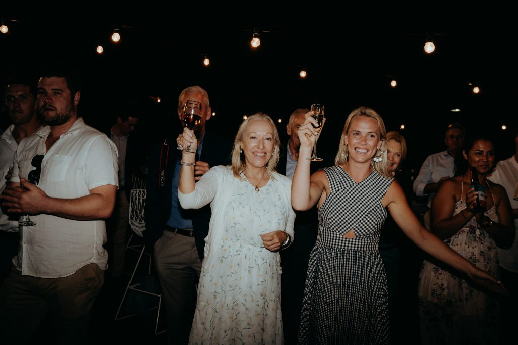 two women with champagne glasses at Broome wedding